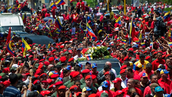 The hearse carrying the coffin of Hugo Chavez travels through the streets of Caracas