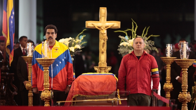 Vice President Nicolas Maduro (left) stands beside the coffin of Hugo Chavez at the military academy in Caracas