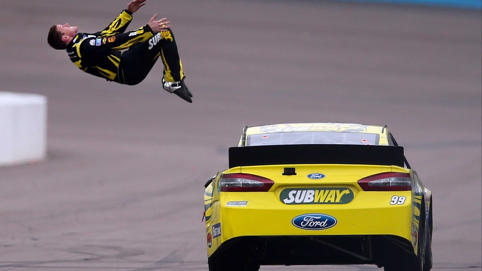 Carl Edwards performs a back flip after winning the NASCAR Sprint Cup Series Subway Fresh Fit 500 in Phoenix