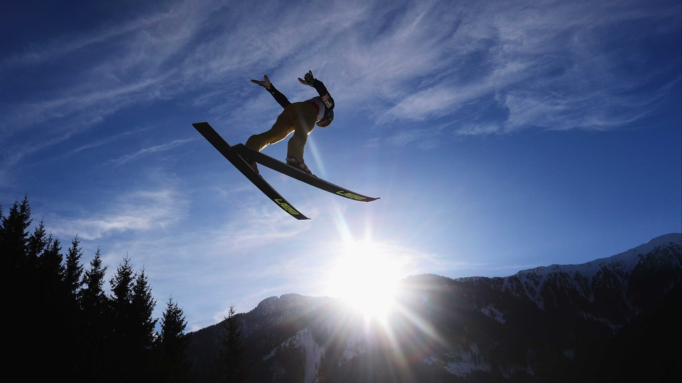 A ski-jumper in action at the FIS Nordic World Ski Championships in Val di Fiemme, Italy