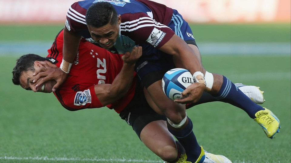 Francis Saili fends off Daniel Carter during the Super Rugby match between the Blues and the Crusaders at Eden Park in Auckland