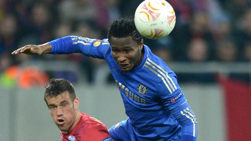 John Obi Mikel (r) of Chelsea fights for the ball with Mihai Doru Pintilii of Steaua Bucharest