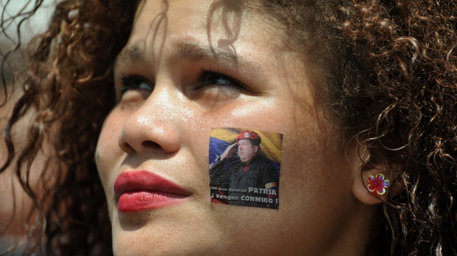 A mourner waits in line to pay her last respects to late Hugo Chavez