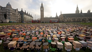 Cardboard characters outside the Houses of Parliament organised by Fairtrade Foundation to draw attention to the plight of smallholder farmers