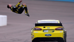 Carl Edwards, driver of the #99 Subway Ford, performs a back flip to celebrate after winning the NASCAR Sprint Cup Series Subway Fresh Fit 500 at Phoenix International Raceway in Avondale, Arizona.