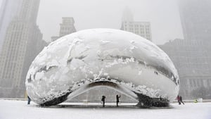 The sculpture 'Cloud Gate', commonly known as 'the bean' covered in snow in Chicago, Illinois.