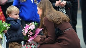 Catherine, Duchess of Cambridge meets three-year-old Olllie Axel  as she visits Humberside Fire and Rescue Peaks Lane Fire Station