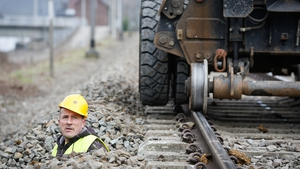 A man checks the first European Train Control System line in Profondeville, Wallonia