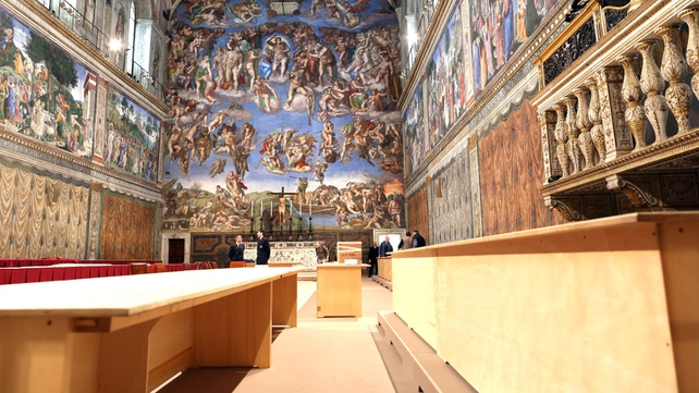 Workers prepare the Sistine Chapel for conclave