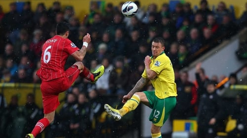 Southampton's Jose Fonte clashes with Anthony Pilkington of Norwich