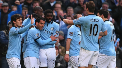 City players congratulate Carlos Tevez after the first of his three goals