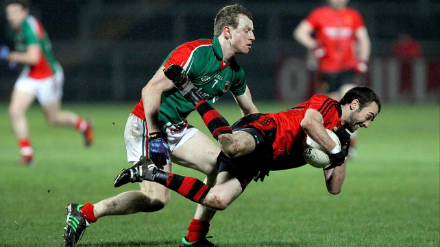 Conor Laverty goes to ground under a challenge from Mayo's Colm Boyle