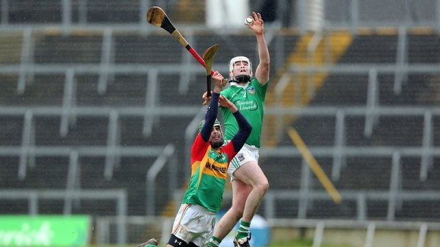 Craig Doyle of Carlow with Tom Condon of Limerick