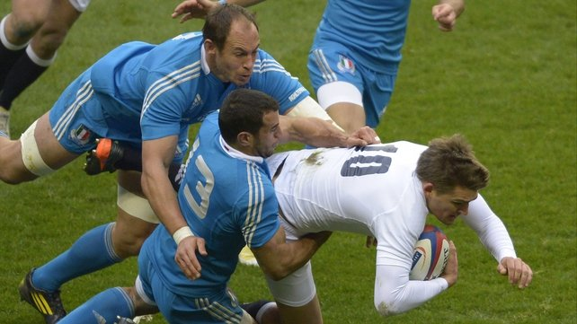 England outhalf Toby Flood is tackled by Gonzalo Canale and Sergio Parisse