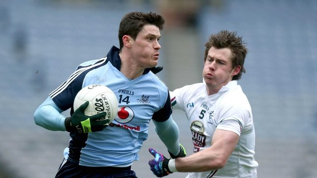 Diarmuid Connolly of Dublin holds off Kildare's Emmet Bolton
