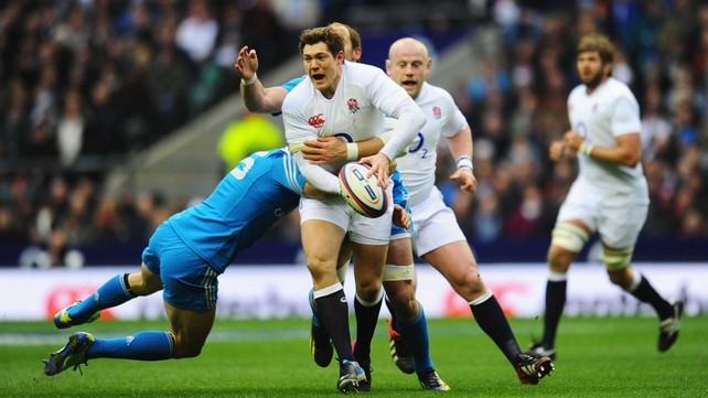 Andrea Masi tackles Alex Goode