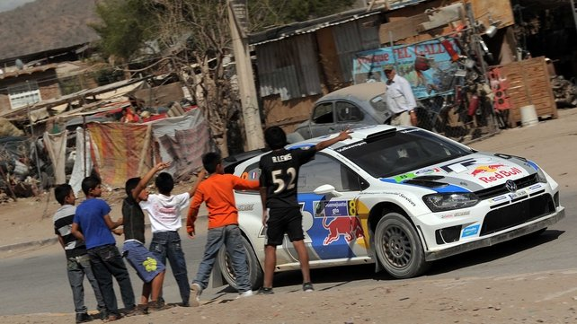 Children in Mexico watch a passing Sebastien Ogier