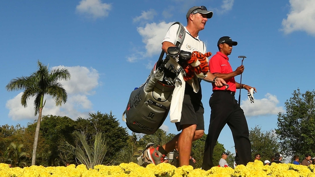 Tiger Woods alongside his caddie Joe LaCava during the final round today