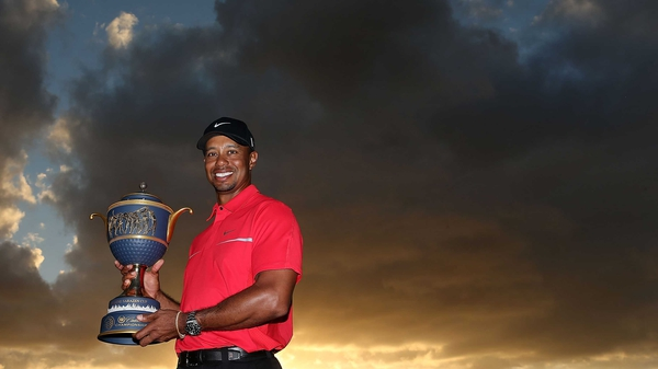 Tiger Woods poses with the Gene Sarazen Cup after his two-stroke victory