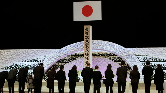 Relatives pay tribute during a national memorial service in Tokyo