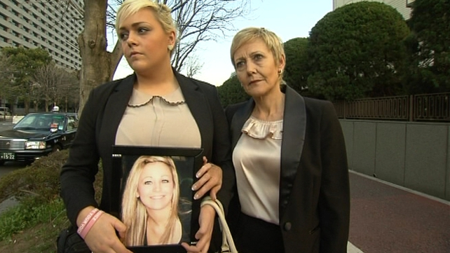 Andrea (L) called for the death penalty while Angela Furlong said a 'heavy cloak of darkness' surrounds her family