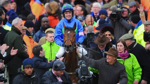 Hurricane Fly and Ruby Walsh celebrate Champion Hurdle success at Cheltenham