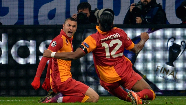 Yilmaz celebrates his goal in the company of Didier Drogba