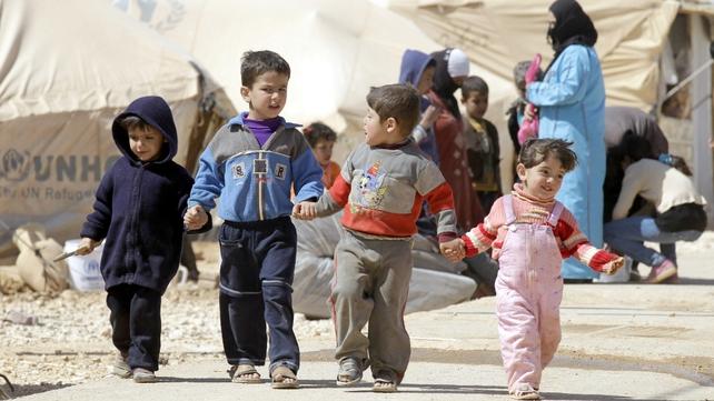 Syrian children walk amid tents at the Zaatari refugee camp, near the Syrian border with Jordan