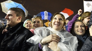 Thousands of people had waited in the cold and rain since Tuesday to see white smoke