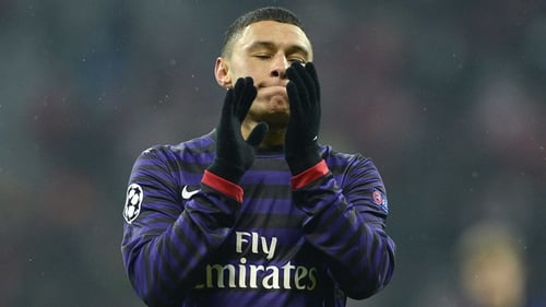 Alex Oxlade-Chamberlain reacts to Arsenal's Champions League exit