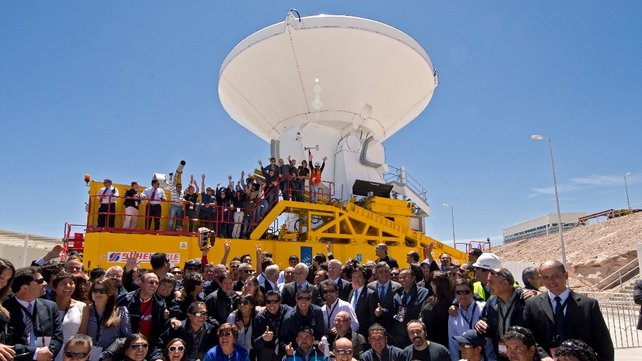 Chile's President Sebastian Pinera poses with workers after the inauguration of the ALMA Observatory