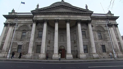 The man and his wife are suing the HSE and three laboratories over the alleged misreading of a cervical smear test in 2010