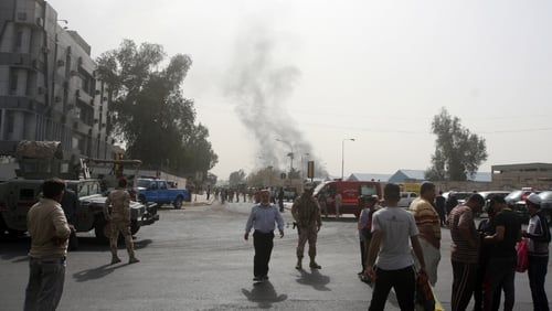 Smoke billows from the scene of a car bomb attack in Baghdad earlier today