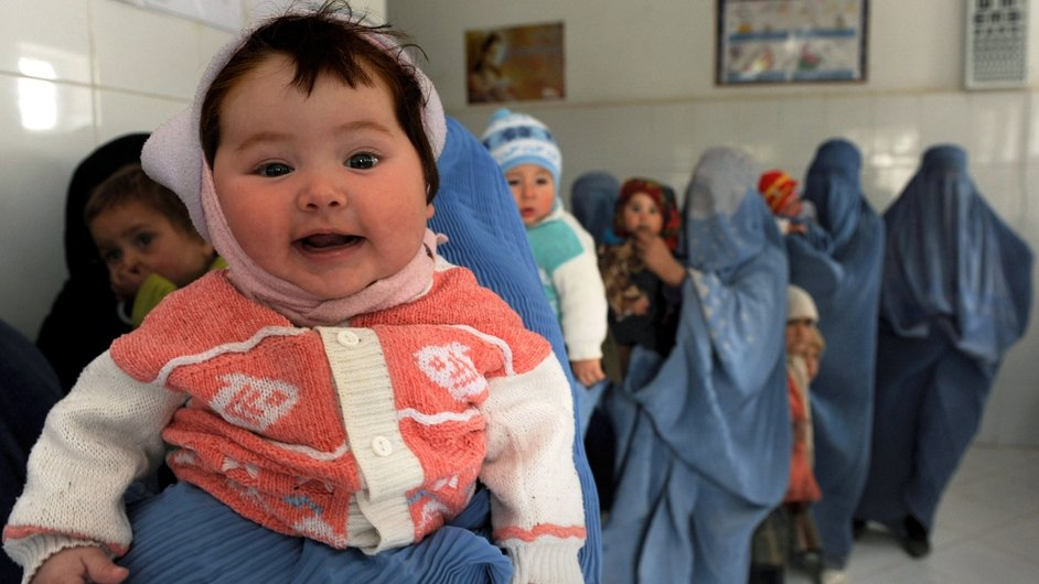 A young girl waits to receive a polio vaccination at a clinic in Herat, Afghanistan