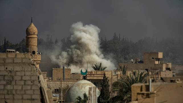 Smoke rises from the site of a missile attack on rebel positions in the eastern Syrian town of Deir Ezzor