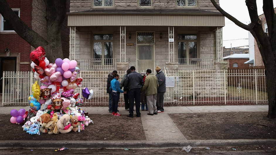 Local residents in Chicago pay tribute to six-month-old Jonylah Watkins, who died after being shot five times while her father changed her nappy in a minivan