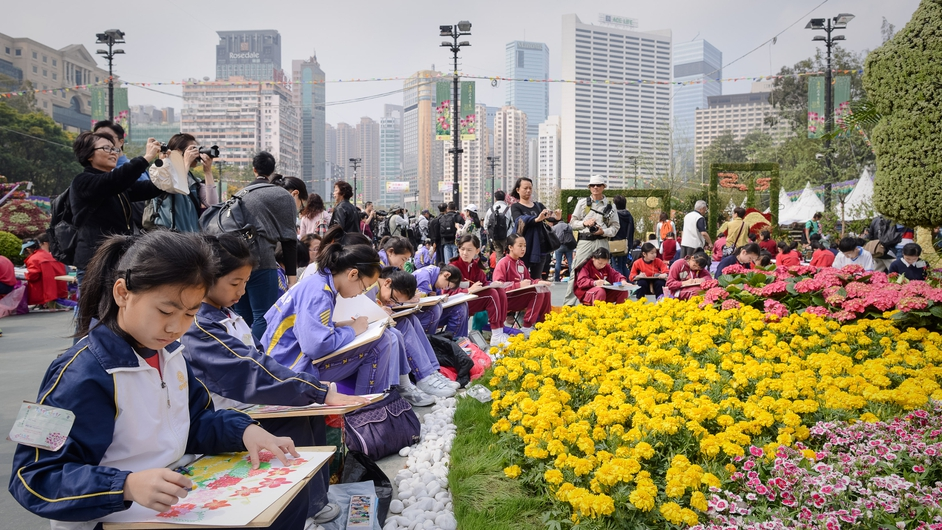 Children draw sketches at the Hong Kong flower show. Organisers expect more than 500,000 visitors over the course of the ten-day event