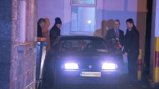 Kevin McGeever (wearing hat) leaves Gort Garda Station this evening