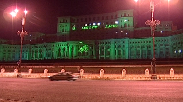 Bucharest's Palace of Parliament is lit up in green