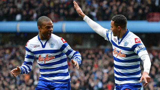 Goalscorer Jermaine Jenas (r) celebrates with QPR team-mate Loic Remy