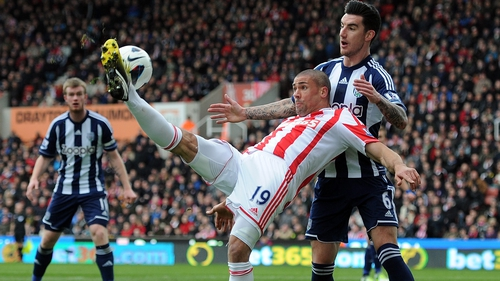 Ireland international Jonathan Walters is well marshalled by West Brom's Liam Ridgewell