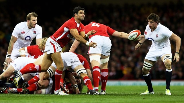 Wales' Mike Phillips feeds his backline against England