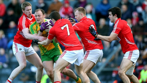 Donegal's Colm McFadden is put under pressure by Andrew O'Sullivan,Tomas Clancy, Michael Shields and Jamie O'Sullivan of Cork