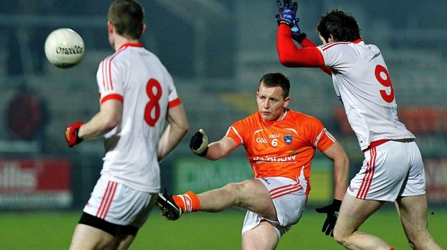 Armagh's Declan McKenna under pressure from Louth duo Paddy Keenan and Brian Donnelly