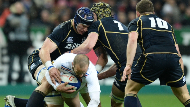 France's Frederic Michalak is tackled by Scotland's Kelly Brown