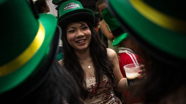 A group of women celebrate St Patrick's Day during the Singapore street festival