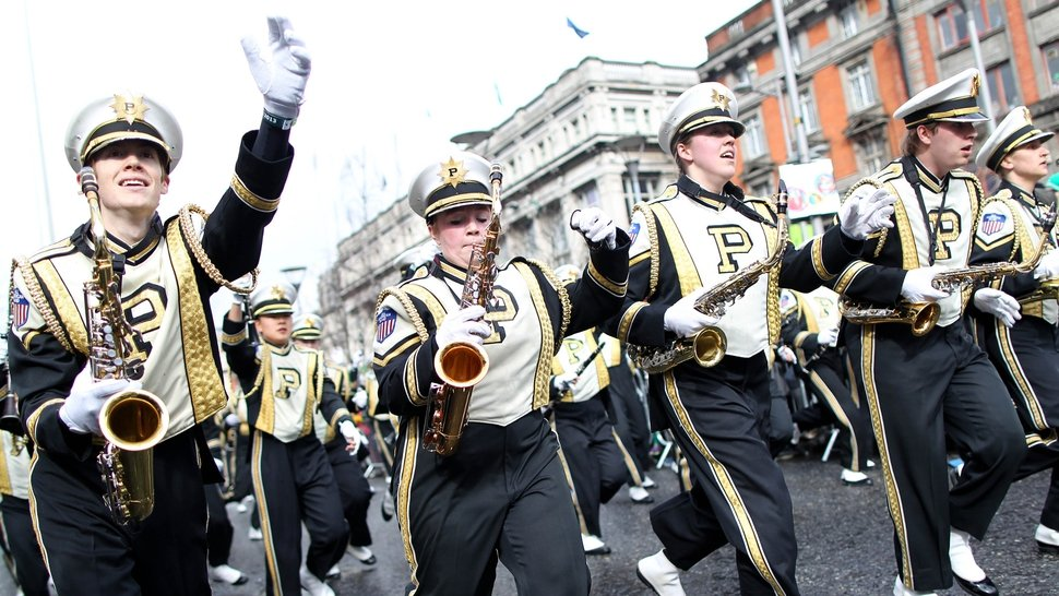 Members of the Purdue University Band march down O'Connell Street