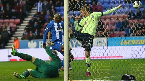 Arouna Kone grabbed a controversial late winner as Wigan maintained their push for Premier League survival