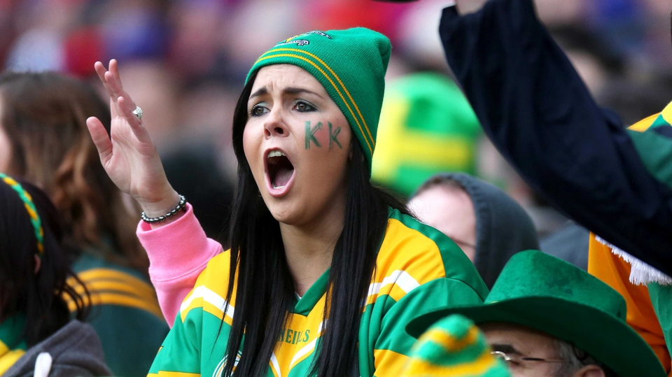 A Kilcormac-Killoughey fan urges her team on from the stands