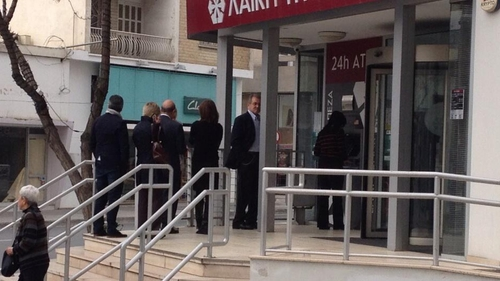 Anxious bank customers queued to withdraw money from one of the few operating ATMs in Cyprus (Pic: Will Goodbody)